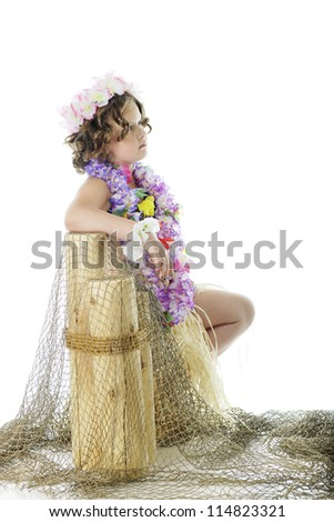 A contemplating elementary hula girl leaning against net covered pier posts.  On a white background. - stock photo