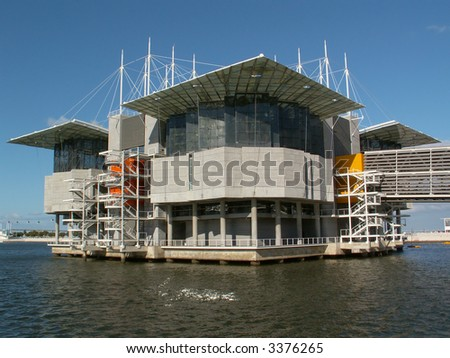 A contemporary architecture building suspended on water - stock photo