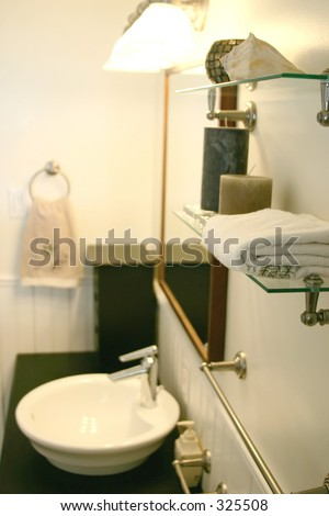 A contemporary bathroom.  Main focus is on the towel in the foreground. - stock photo