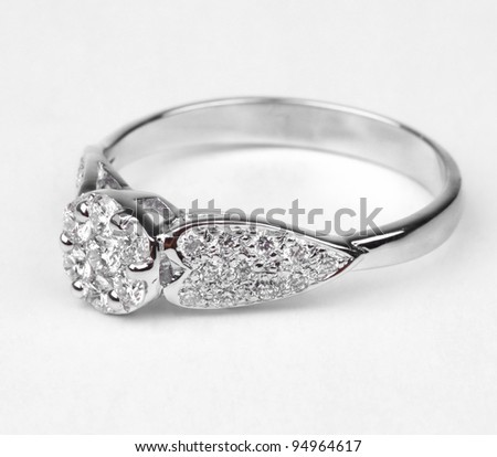 A contemporary diamond ring isolated on white background. - stock photo
