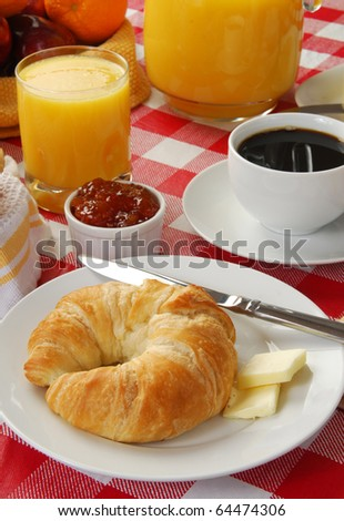 A continental breakfast with rolls, coffee and orange juice - stock photo