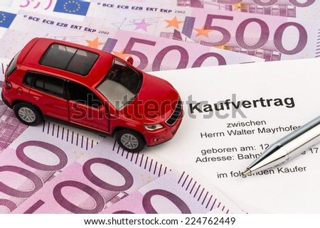 a contract of sale for buying a car at the car dealer. cars - stock photo