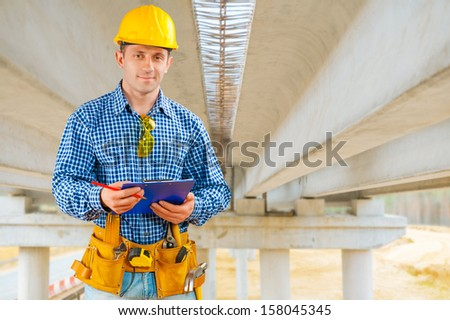 a contractor under the bridge under construction - stock photo
