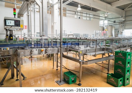 A conveyor belt with packs for beer is seen during production process in the  Molson Coors Kamenitza beer brewery, April 28, 2015, near the city of Haskovo, Bulgaria.