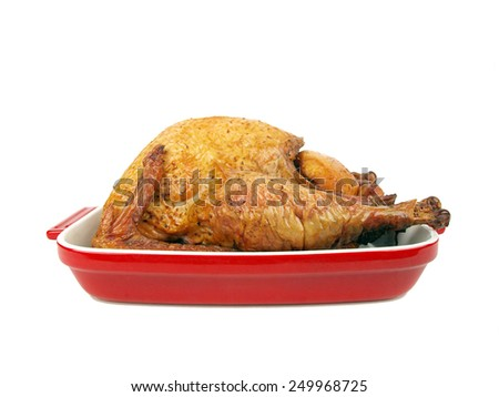 a cooked whole smoked turkey in a ceramic tray - stock photo