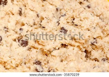 A cookie dough detail with wood spoon - stock photo