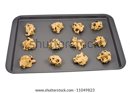 A cookie sheet of chocolate chip cookies ready for the oven. - stock photo
