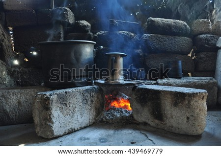 A cooking fire in an old stone kitchen at a ranch in Mexico