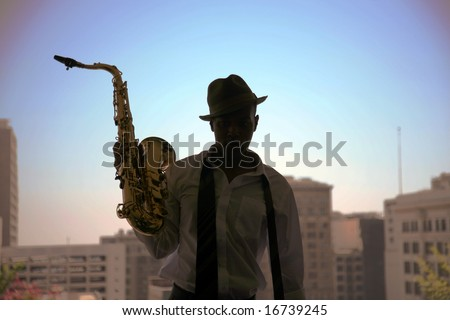 a cool cat takes a quick break from playing his sax in these moody images - stock photo