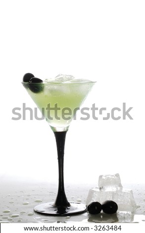 a cool iced drink,ice cubes and olives - stock photo