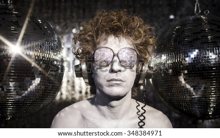 a cool silver club character listening to music in a disco setting  - stock photo