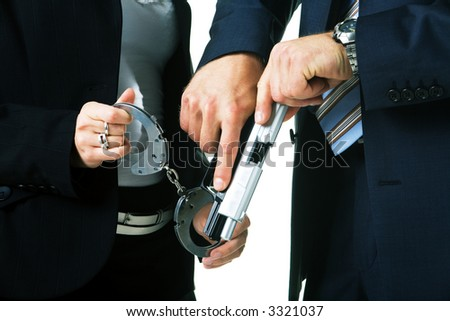 A cop couple,  handgun, handcuffs - stock photo
