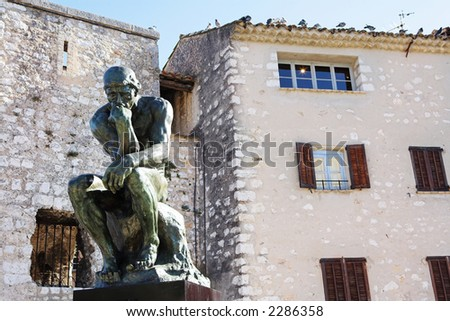 A copy of the famous bronze sculpture of Auguste Rodin – The Thinker (originally called  The Poet) in St Paul, France - stock photo