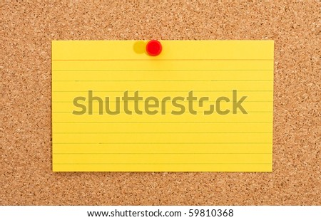 A cork bulletin board with index card, Notice