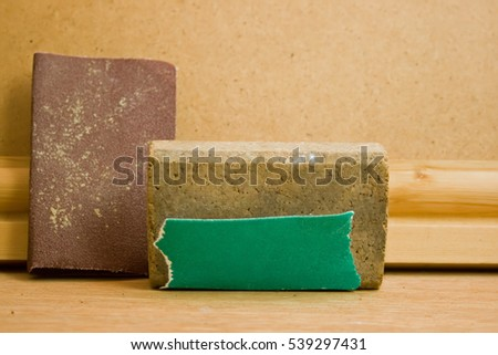 A cork sanding block. Also sandpaper and timber.