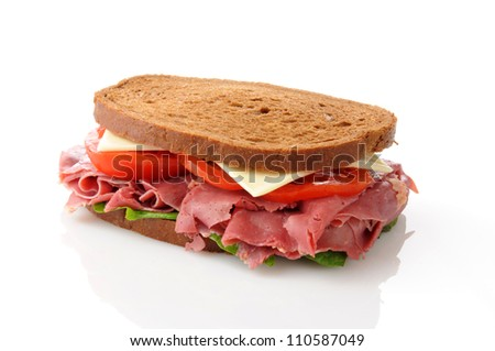 A corned beef sandwich on a white background - stock photo
