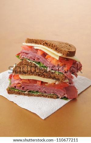 A corned beef sandwich on dark rye - stock photo