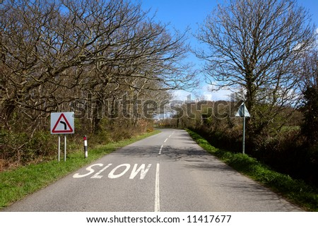 A corner on an English country road in Cornwall UK. - stock photo