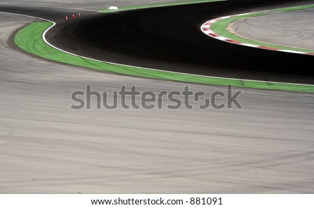 a corner on racing cicuit - stock photo