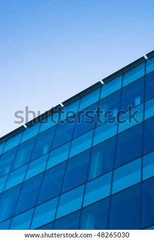 A corporate building with a blue sky with space for copy.