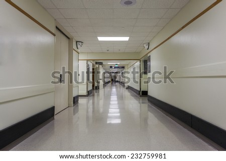 A corridor in a nice, modern hospital. - stock photo