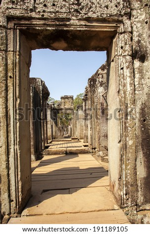 A corridor in Angkor Thom temple, Siemriep, Cambodia. Angkor Thom and angkor Wat is the score tourist row the first on the world. - stock photo