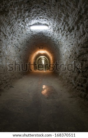 A corridor inside the Turda salt mine from Romania. The Turda saline has been known since ancient times and is now a major tourist attraction, also used as medical therapy.