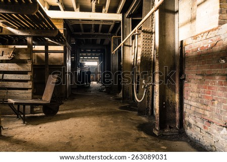 A corridor next to the ovens that were used for baking pottery. - stock photo