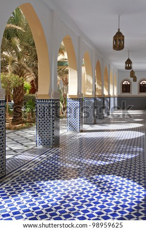 A corridor with arches and tiles in traditional Moroccan style - stock photo