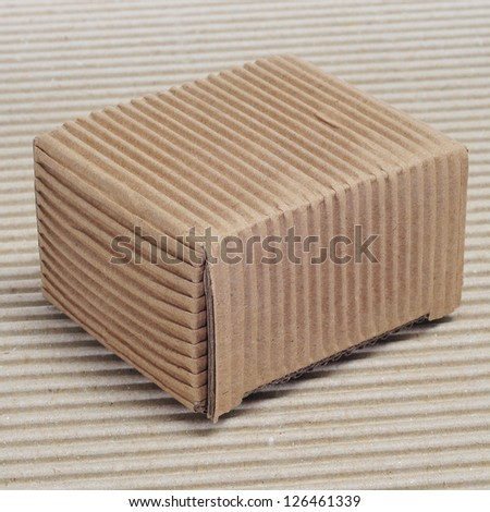 a corrugated cardboard box on a corrugated cardboard background - stock photo