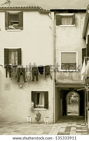 a cosy yard with drying linen on Burano - Venice, Italy (stylized retro)