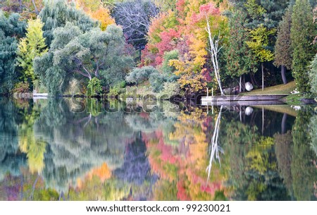 A cottage dock during the splendor of Autumn. - stock photo