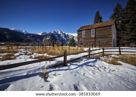 a cottage in the mountains - stock photo