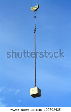 A counterweight suspended with a chain in the air - stock photo