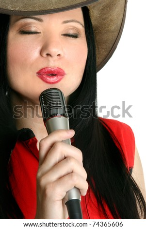 A country and western singer entertainer performing.  White background. - stock photo