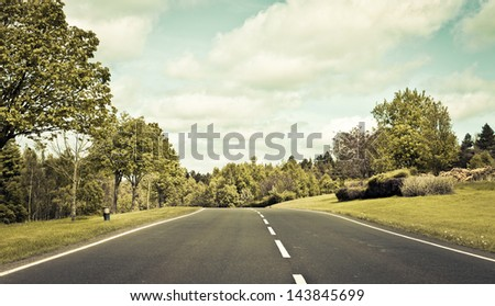 A country road in the UK in muted vintage tones - stock photo