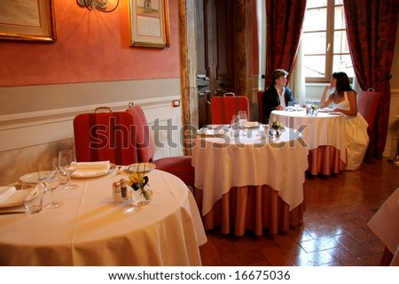 a couple a luxury restaurant - stock photo