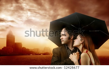 a couple and a sunset on a city - stock photo