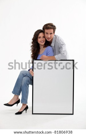 a couple and a white panel/ copyspace