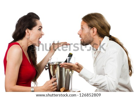 A couple arguing over a glass of Champagne on their Valentine's day date. Isolated on white.