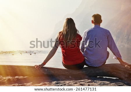 A couple at a mountain lake - stock photo