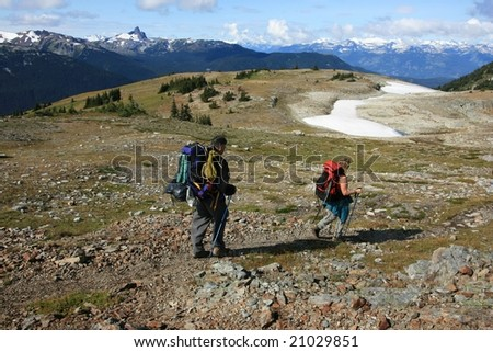 A couple backpacking at Oboe Summit in Garibaldi Provincial Park, British Columbia, Canada.