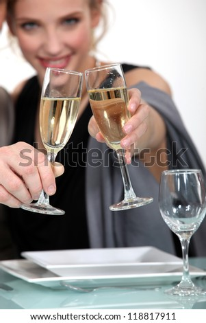 A couple celebrating with a glass of champagne