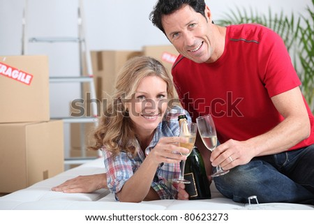 A couple celebrating with champagne.
