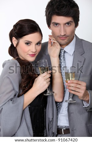 A couple drinking champagne.