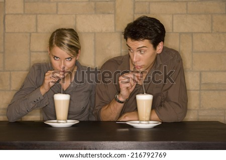 A couple drinking coffee. - stock photo