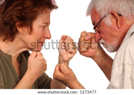 A couple duke it out - stock photo