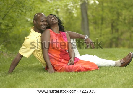 a couple enjoying each other in Spring
