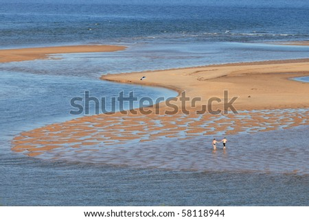 A couple enjoying the day on the sea (Ria Formosa, Algarve, south coast of Portugal). - stock photo