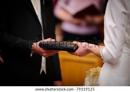 A couple exchange vows at a wedding ceremony - stock photo
